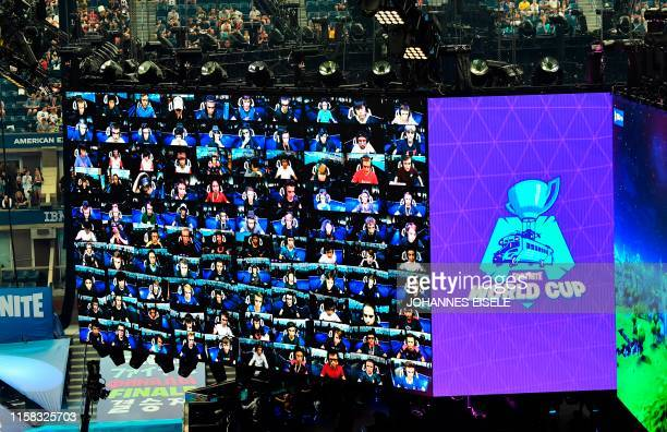 Players are seen on screen during the final of the Solo competition at the 2019 Fortnite World Cup July 28 2019 inside of Arthur Ashe Stadium in New...