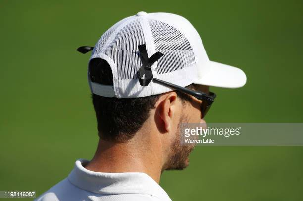 Players are seen wearing a black ribbon in remembrance of caddie James Rae during Day 1 of the South African Open at Randpark Golf Club on January 09...