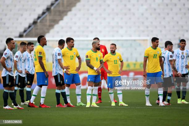 Players Argentina and Brazil wait as the match is delayed by Brazilian health authorities during a match between Brazil and Argentina as part of...