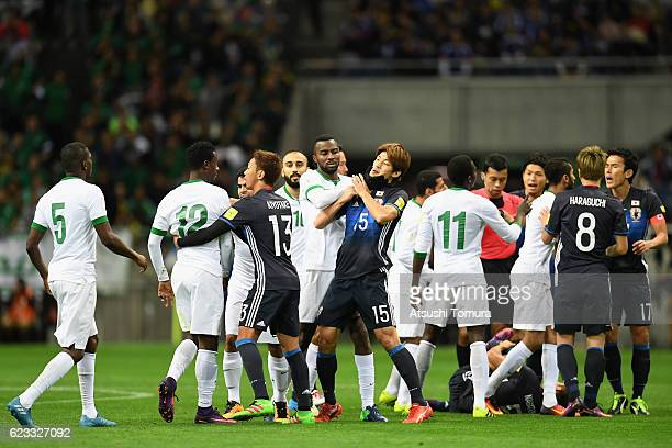 Players argue after Yuto Nagatomo of Japan is challenged during the 2018 FIFA World Cup Qualifier match between Japan and Saudi Arabia at Saitama...