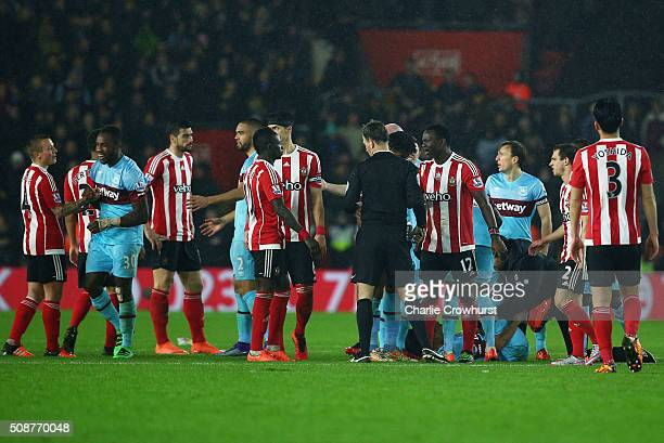 Players argue as Victor Wanyama of Southampton is sent off by referee Mark Clattenburg during the Barclays Premier League match between Southampton...