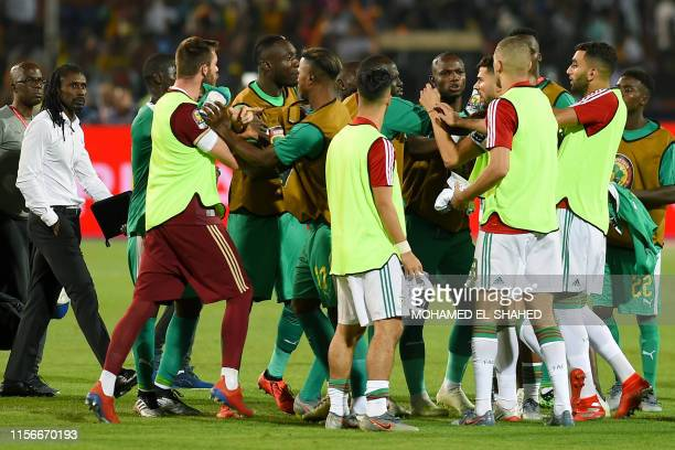 Players argue during the 2019 Africa Cup of Nations Final football match between Senegal and Algeria at the Cairo International Stadium in Cairo on...