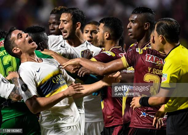 Players argue during the 2019 Copa Libertadores football match between Argentina's Boca Juniors and Colombia's Deportes Tolima at Manuel Murillo Toro...