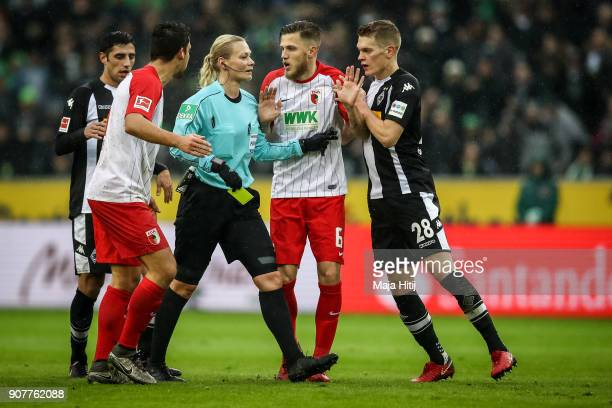 Players argue with Referee Bibiana Steinhaus during the Bundesliga match between Borussia Moenchengladbach and FC Augsburg at BorussiaPark on January...