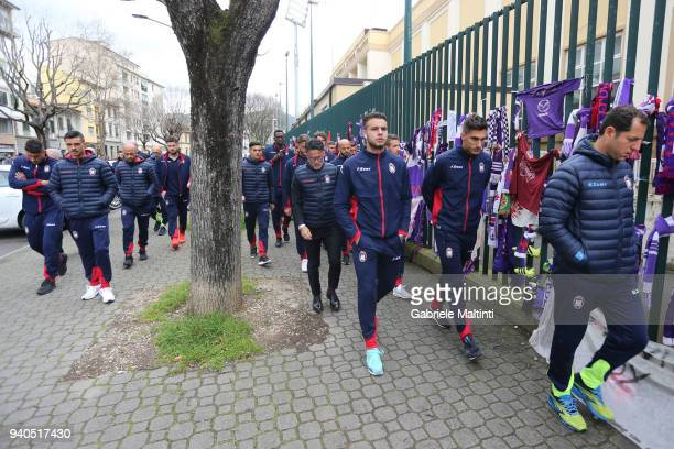 FC players arrive after remembering former captain Davide Astori of ACF Fiorentina by leaving a bunch of flowers and a pennant with the signatures of...