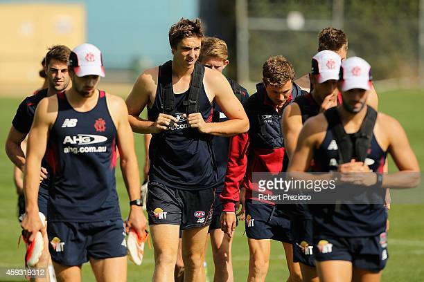 Players arrive during a Melbourne Demons media session at Gosch's Paddock on November 21 2014 in Melbourne Australia