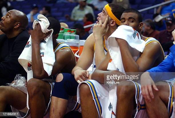 UCLA players Arron Afflalo Michael Ffefy and Josh Shipp sit on the bench dejectedly in the final minute of 7972 firstrouond loss to Oregon State in...