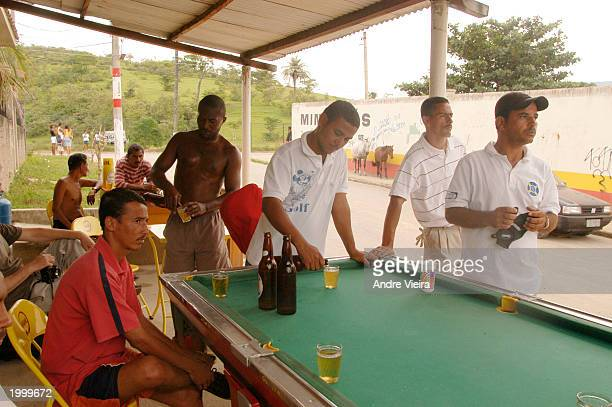 Players at Japeri Municipal Public Golf Course take a break from playing at a bar a few feet from the course May 14 2003 in Rio de Janeiro suburb of...