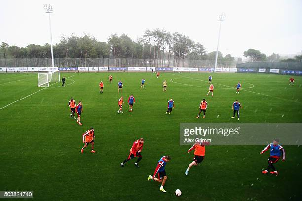 Players attend a Hamburger SV training session in the rain on day 2 of the Bundesliga Belek training camps at Sueno Deluxe Hotel Sports Center on...