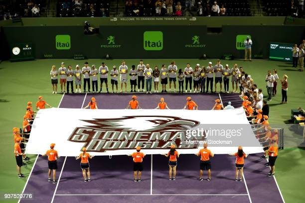 Players ball kids and students from the tennis team of Marjory Stoneman Douglas High School participate in a ceremony in tribute to the victims of a...