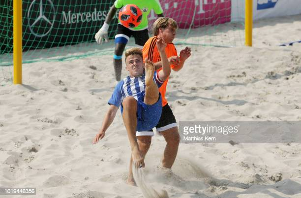 Players battle for the ball during the German Beachsoccer League 3rd place match between Real Muenster and Hertha BSC Beachsoccer on August 19 2018...