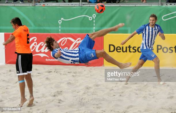 Players battle for the ball during the German Beachsoccer League 3rd place match between Real Muenster and Hertha BSC Beachsoccer on August 19, 2018...