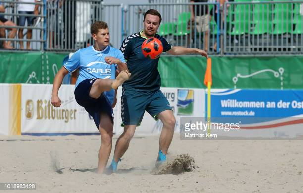 Players battle for the ball during the German Beachsoccer Tour semi final match between Ultima Reserva do Brasil and Asche Ballsport Kaerlich on...