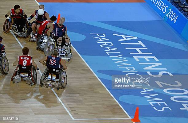 Players battle for the ball during the Wheelchair Rugby mach between USA and Japan at the Athens 2004 Paralympic Games on September 19 2004 in Athens...