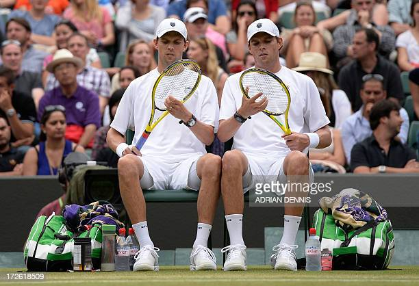 US players Bob Bryan and Mike Bryan sit between games against India's Rohan Bopanna and France's Edouard RogerVasselin in their men's doubles...