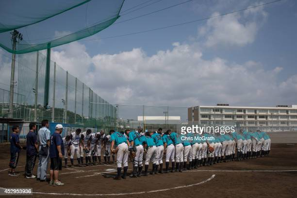 Players bow to the diamond after finishing play during a practice game between the Shonan Boys and the Yokohama Minami on July 30 2014 in Yokosuka...