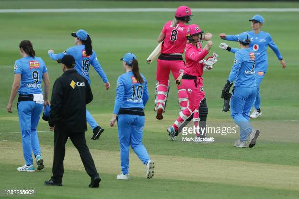 Players bump fists at the end of the Women's Big Bash League WBBL match between the Sydney Sixers and the Adelaide Strikers at North Sydney Oval on...