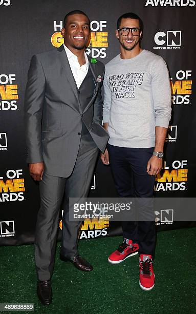 NFL players Cam Newton and Colin Kaepernick attend Cartoon Network's Hall of Game Awards press room at Barker Hangar on February 15 2014 in Santa...