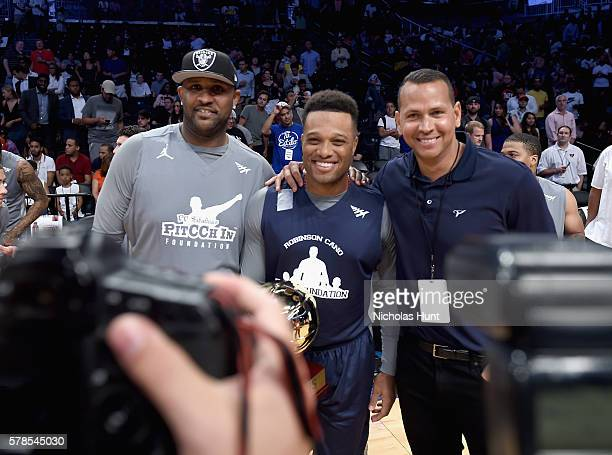 MLB players CC Sabathia Robinson Canó and Alex Rodriguez pose with a trophy at the Roc Nation Summer Classic Charity Basketball Tournament at...