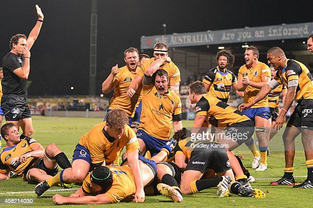 Players celebrate a try by Pettowa Paraka of Brisbane City during the 2014 NRC Grand Final match between Brisbane City and Perth Spirit at Ballymore...