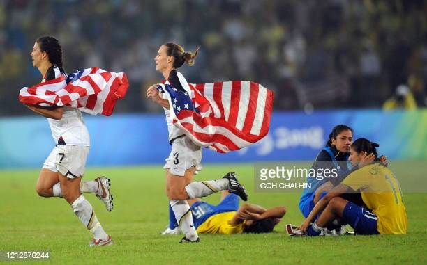 US players celebrate after beating Brazil 10 in the final of the women's football competition in the 2008 Beijing Olympic Games in Beijing on August...