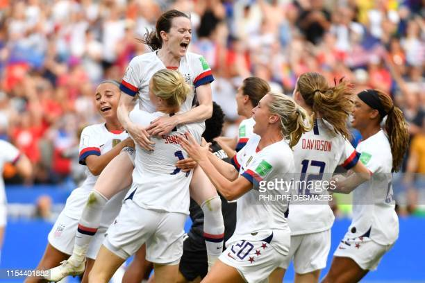 TOPSHOT USA players celebrate after the final whistle during the France 2019 Womens World Cup football final match between USA and the Netherlands on...