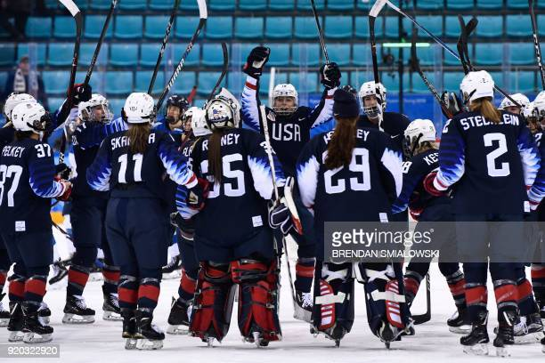 TOPSHOT US players celebrate after the women's ice hockey semifinal game between the United States and Finland during the Pyeongchang 2018 Winter...