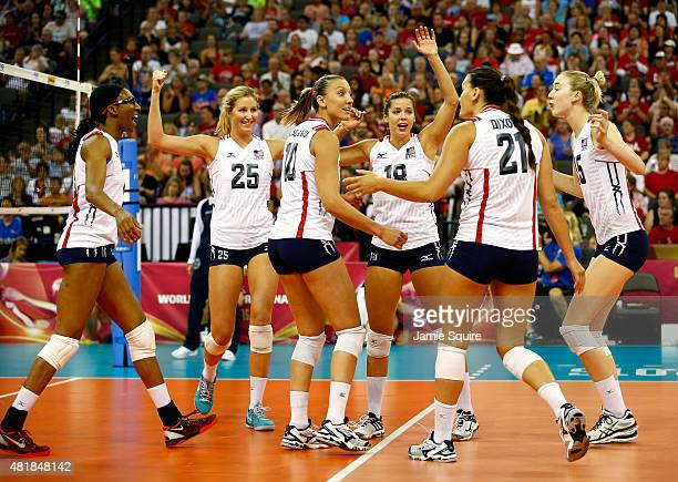 USA players celebrate after winning a point during the final round match against Russia on day 3 of the FIVB Volleyball World Grand Prix on July 24...