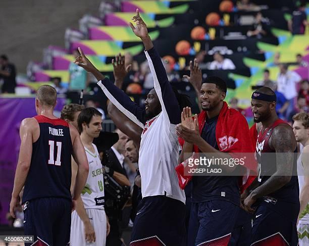 US players celebrate after winning the 2014 FIBA World basketball championships quarterfinal match Slovenia vs USA at the Palau Sant Jordi arena in...