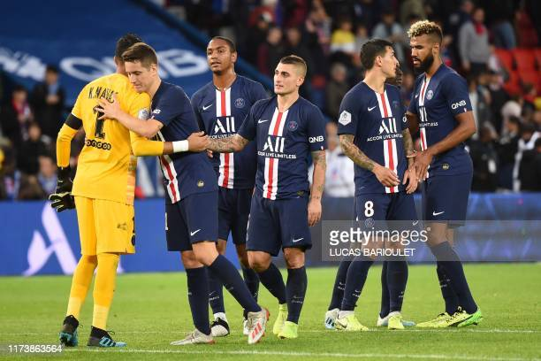 Players celebrate after winning the French L1 football match between Paris Saint-Germain and Angers SCO at the Parc des Princes stadium in Paris on...