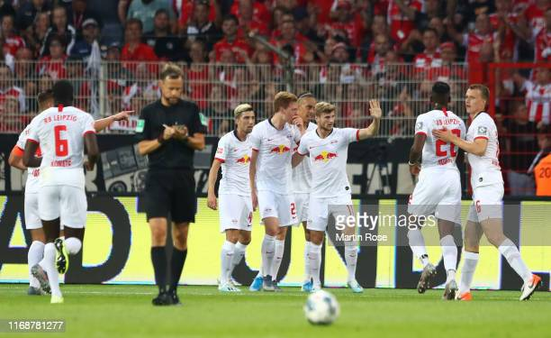 Players celebrate as Marcel Halstenberg of RB Leipzig scores his team's first goal during the Bundesliga match between 1. FC Union Berlin and RB...