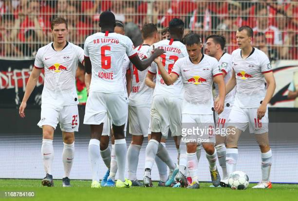 Players celebrate as Timo Werner of RB Leipzig scores his team's third goal during the Bundesliga match between 1 FC Union Berlin and RB Leipzig at...