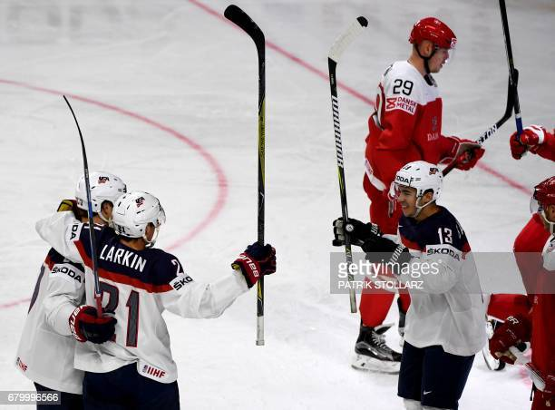 Players celebrate during IIHF Icehockey world championship first round match between USA and Denmark in the LANXESS arena in cologne , western...