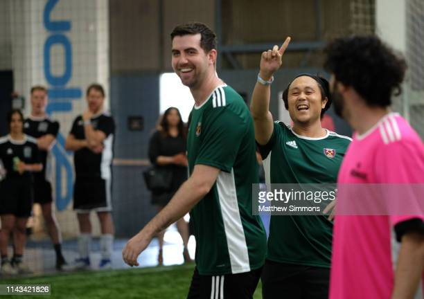 Players celebrate during the Copa Del Rave Charity Soccer Tournament at Evolve Project LA on April 17 2019 in Los Angeles California