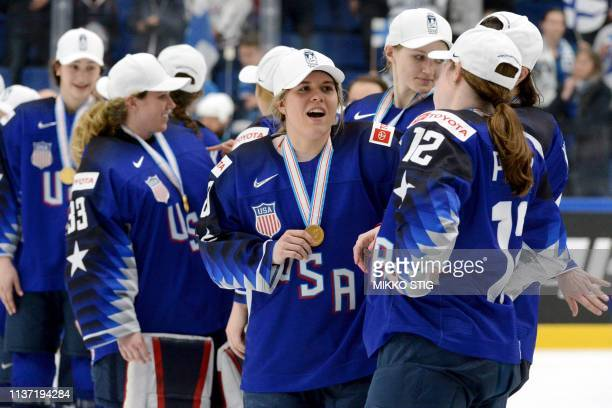 US players celebrate during the medal ceremony after their 21 shootout victory in the IIHF Women's Ice Hockey World Championships final match between...