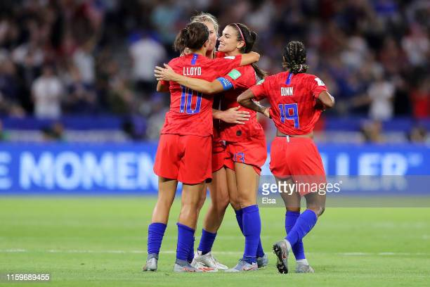 USA players celebrate following their sides victory in during the 2019 FIFA Women's World Cup France Semi Final match between England and USA at...
