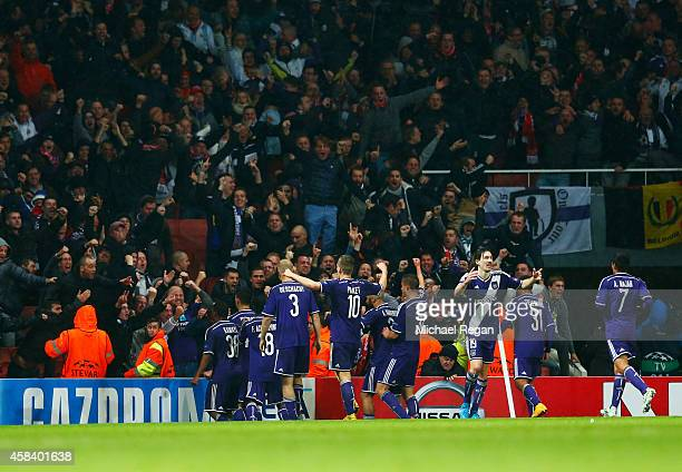 Players celebrate in front of their fans as Aleksandar Mitrovic of Anderlecht scores their third goal during the UEFA Champions League Group D match...