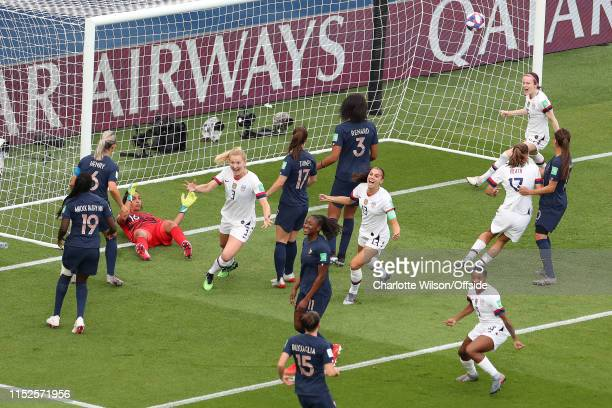 USA players celebrate the opening goal scored by Megan Rapinoe from a freekick as dejected France players look on during the 2019 FIFA Women's World...