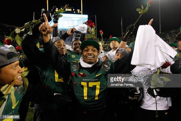 Players celebrate the Oregon Ducks 4931 victory over the UCLA Bruins during the Pac 12 Championship Game on December 2 2011 at the Autzen Stadium in...