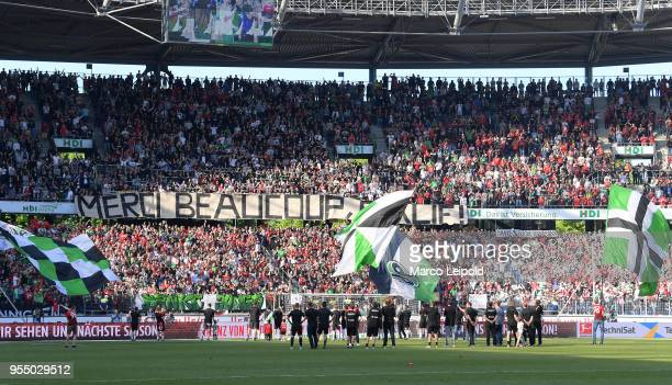 players celebrate the win with fans of Hannover 96 after the Bundesliga game between Hannover 96 and Hertha BSC at HDI Arena on May 5 2018 in...