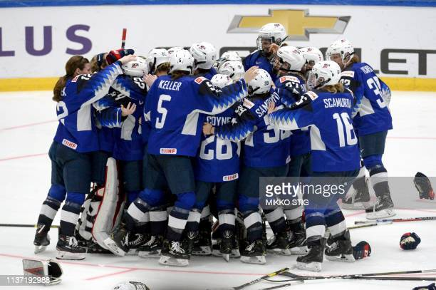 US players celebrate their 21 shootout victory after the IIHF Women's Ice Hockey World Championships final match between the United States and...