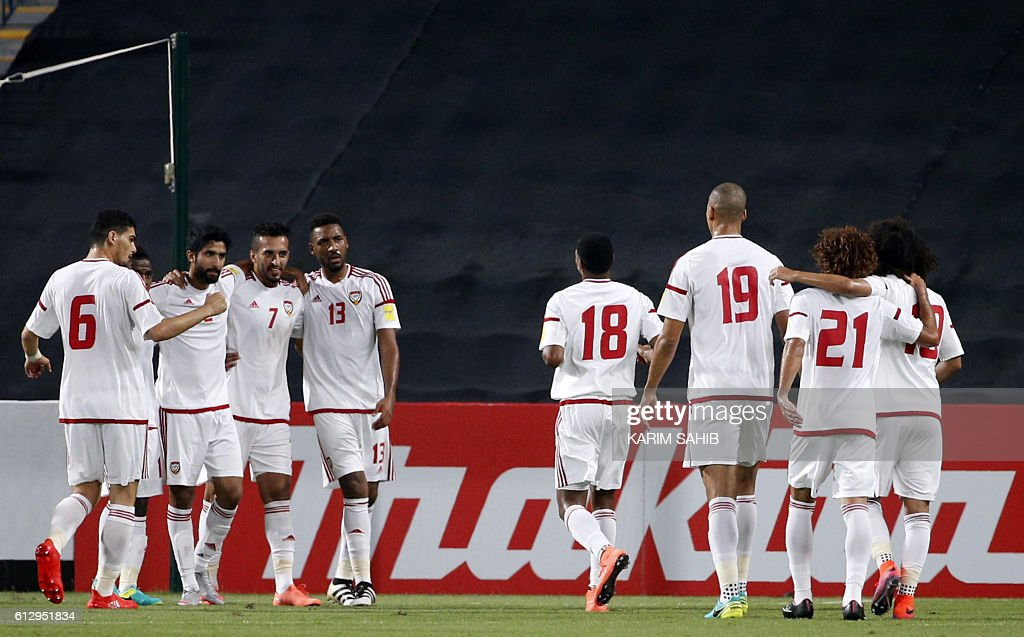 UAE players celebrate their opening goal, scored by Ali Mabkhout (#7), during the 2018 FIFA World Cup Qualifiers match between United Arab Emirates and Thailand at the Mohammed Bin Zayed Stadium in Abu Dhabi on October 6, 2016. / AFP / KARIM