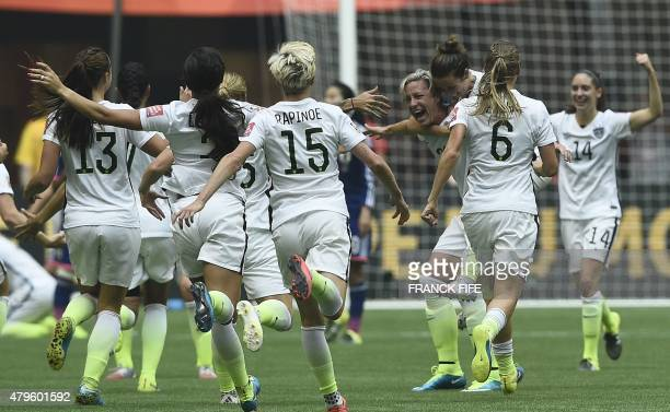 Players celebrate their victory in the final football match between USA and Japan during their 2015 FIFA Women's World Cup at the BC Place Stadium in...