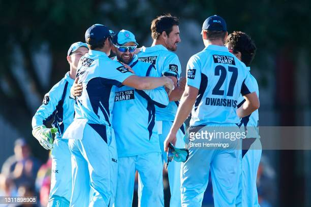 Players celebrate victory during the 2021 Marsh One Day Cup Final match between New South Wales and Western Australia at Bankstown Oval on April 11,...