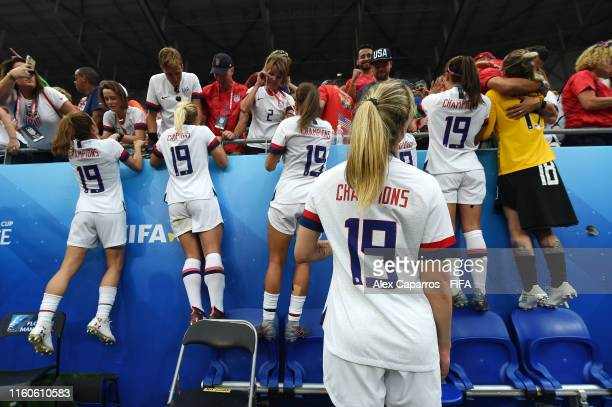 USA players celebrate victory with family and friends in the crowd after the 2019 FIFA Women's World Cup France Final match between The United States...