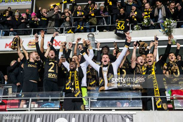 AIK players celebrate winning the 2018 Allsvenskan season by lifting the Lennart Johansson trophy during an Allsvenskan match between Kalmar FF and...