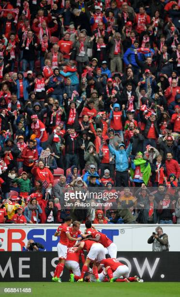 Players celebrate with fans of FSV Mainz 05 the goal to 1:0 during the game between FSV Mainz 05 and Hertha BSC on april 15, 2017 in Mainz, Germany.