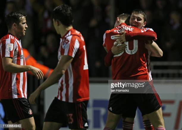 Players celebrate with Lewis Morgan of Sunderland after he scores the second goal during the Checkatrade Trophy Semi Final between Bristol Rovers and...