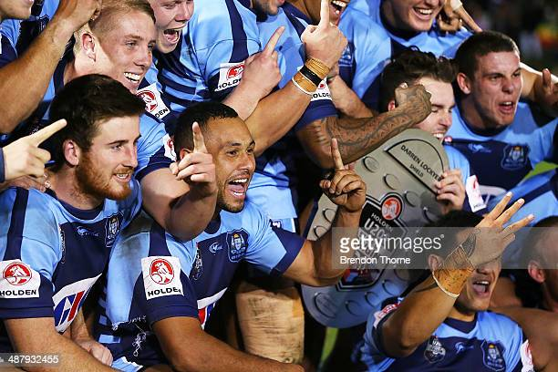 Players celebrate with the Darren Lockyer Trophy after full time following the U20's State of Origin match between the New South Wales Blues and the...