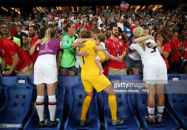 USA players celebrate with their family following their victory in the 2019 FIFA Women's World Cup France Quarter Final match between France and USA...